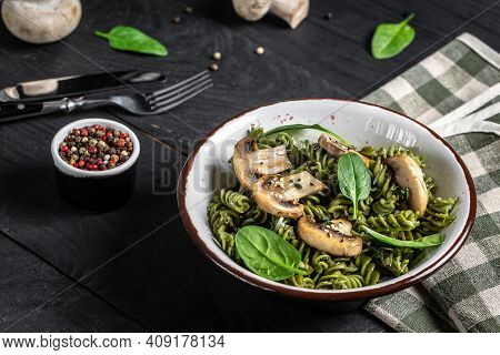 Pasta Penne With Grilled Mushrooms With Spinach. Healthy Vegan Food. Green Vegan Pasta. Food Recipe