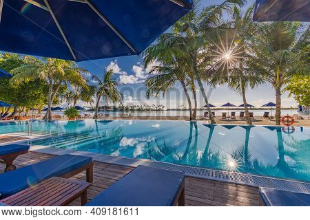 Luxury Beach Resort, Summer Vacation Poolside, Chairs, Beds, Chaise Lounge Concept. Palm Trees With
