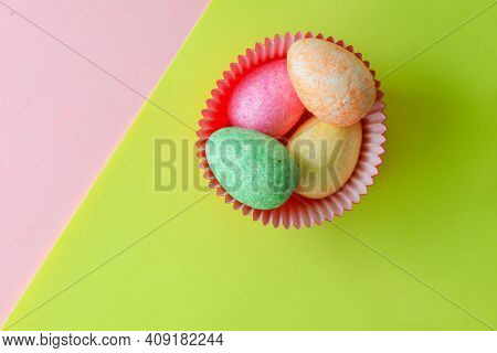 Colorful Easter decorative eggs on colored background