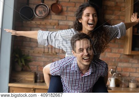 Close Up Smiling Husband Carrying Excited Wife Pretending Flying
