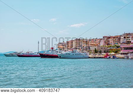 Saranda, Albania - August 5, 2020: City Harbor - Sea Bay With Calm Turquoise Water, Ships And Ferryb