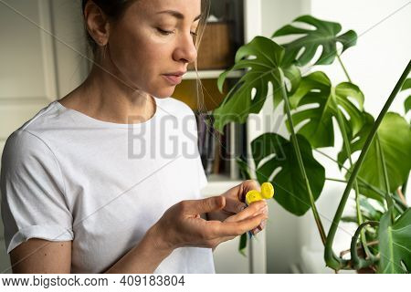 Woman Applying Moisturizing Nourishing Balm To Her Lips With Her Finger To Prevent Dryness And Chapp