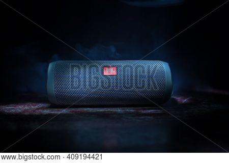 Baku. Azerbaijan - 28.07.2020: Jbl Flip 4 Bluetooth Speaker Close Up Shot On Wooden Table With Color