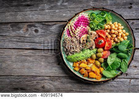Healthy Vegan Lunch Buddha Bowl. Avocado, Quinoa, Tomato, Cucumber, Vegetables Salad. Delicious Brea