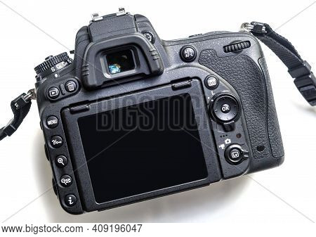 Photo Camera Isolated On White Background, Front View Of Screen Of Professional Dslr Camera Body. Bl
