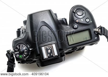 Photo Camera Isolated On White Background, Above View Of Professional Dslr Camera Body. Black Digita