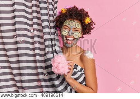 People Hygiene And Cleanliness Concept. Overjoyed Ethnic Woman Has Fun In Douche Takes Shower Holds