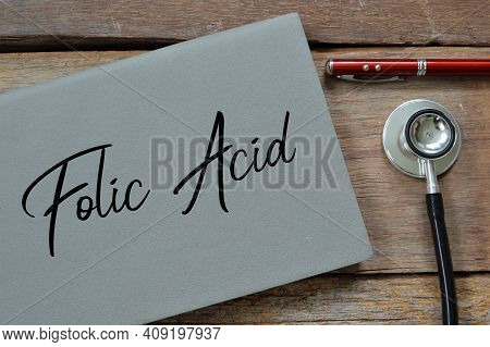 Top View Of Pen, Stethoscope And Notebook Written With Text Folic Acid.