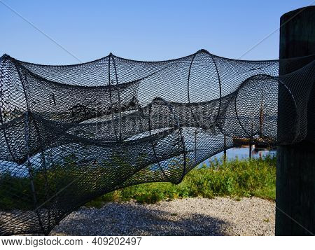 Close Up View Of Fishing Nets Hanged In A Small Fishermen Port Denmark
