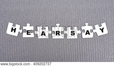 Hearsay - Word Composed Of Paper White Puzzles On A Gray Background. Business Concept