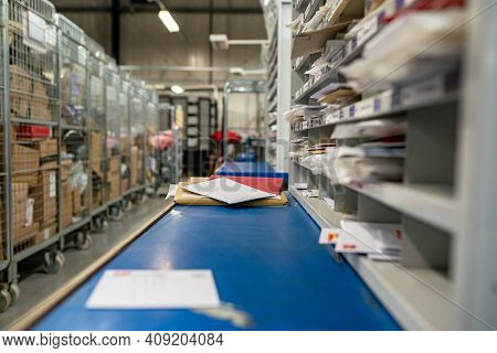 Letters On A Sorting Frame, Table And Shelves In A Mail Delivery Sorting Centre. Postal Service, Pos