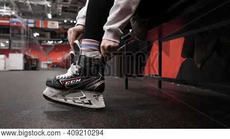 Moscow, Russia - December, 2020: Hockey Player Putting On Skates. Action. Close-up Of Professional H