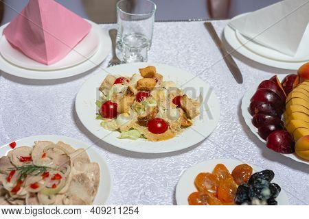 Table Setting, Food And Decorations For Important And Family Events, Delicious Snacks And Hot Dishes