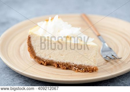 Vegan Coconut Cashew Cheesecake On A Bamboo Plate. Healthy Vegan Pie