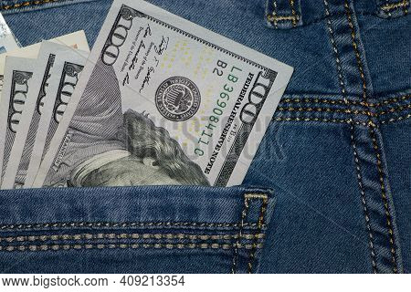 Money In Your Pocket. Dollar Bills In The Pocket Of My Jeans. The Concept Of Pocket Money. Cash. Ame
