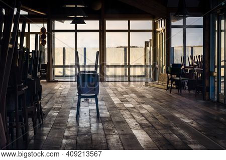 Empty Beach Pavilion With Stacked Chairs And Empty Spaces And Terraces