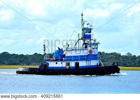 Tugboat Cruising Along The River Background At St. Augustine, Florida.