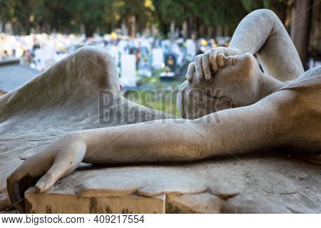 Genoa, Italy - June 2020: Antique Statue Of Angel (1910, Marble) In A Christian Catholic Cemetery -