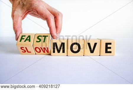 Time To Fast Move Symbol. Businessman Turns A Wooden Cube And Changes Words 'slow Move' To 'fast Mov