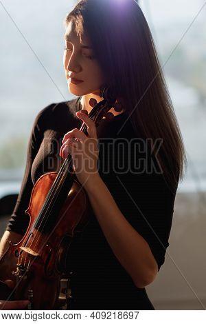 Female Violinist. Conceptual Portrait. Inspiration Muse. Professional Identity. Enjoying Music. Beau