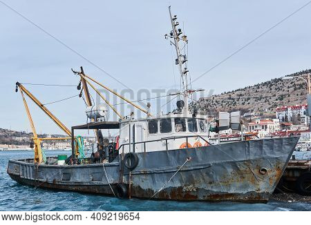 Small Old Fishing Seine Ship Moored In The Harbor