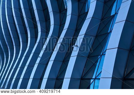Blue Background - An Element Of Contemporary Architecture, A Fragment Of A Whimsically Curved Facade