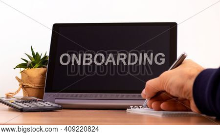 E-business And Onboarding Symbol. Tablet With The Word 'onboarding'. Online Business And Onboarding