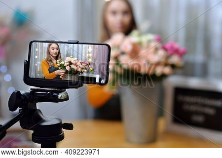 Small Flower Shop. A Woman Writes A Video Blog Or Online Course. Flower School Concept. Florist Woma