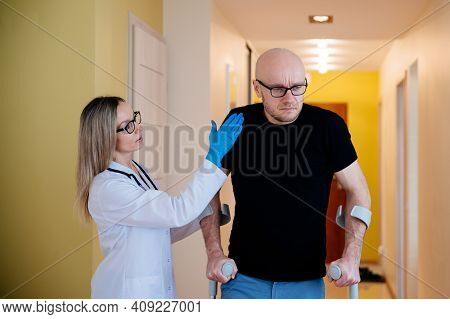 Physical, Doctor, Nurse Therapist Helping Patient In Rehabilitation In His House..