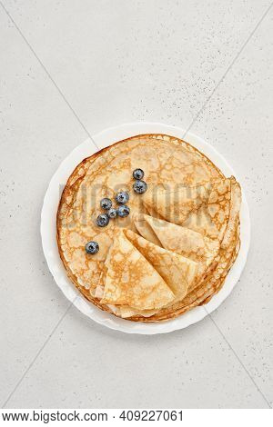 Thin Pancakes, Crepes Or Blini With Berries In White Plate. Top View. Pancake Week. Shrovetide. Spac