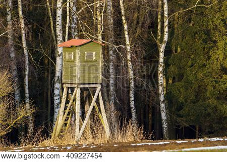 Wooden Lookout Tower For Hunting In The Woods And On Meadow