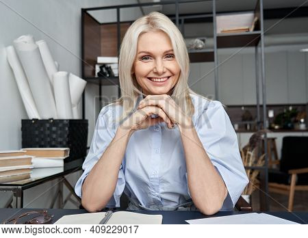 Smiling Mid Aged Business Woman Looking At Web Cam Video Conference Calling In Virtual Chat Meeting,