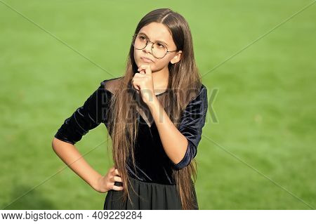 Endearing Geekiness. Little Child Think With Serious Look. Serious Girl Wear Optical Glasses Green G