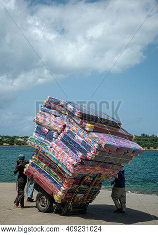 Mombasa, Kenya; 19-08-2018: Cart Loaded With Mattresses By The Sea In Mombasa, Kenya