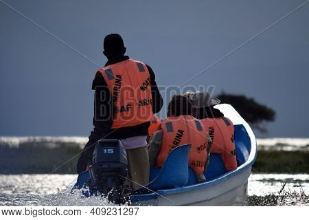 Masai Mara, Kenya; 17-08-2018:  Tourist In A Motorboat Navigating In Naivasha's Lake In Kenya