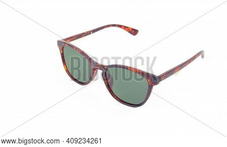 Clothes, Shoes And Accessories - Brown Modern Sunglasses With Green Lenses On A White Background.