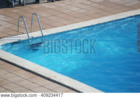 Ladder Of A Swimming Pool In Summer Time