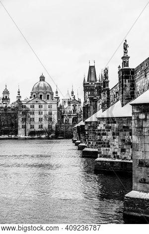 Historical Charles Bridge, Czech: Karluv Most, Over Vltava River In Winter. Prague, Czech Republic.