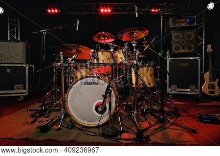 Paris, France - April 4, 2019 : A Drum Kit, A Bass Guitar And Amplifiers On A Stage In Paris