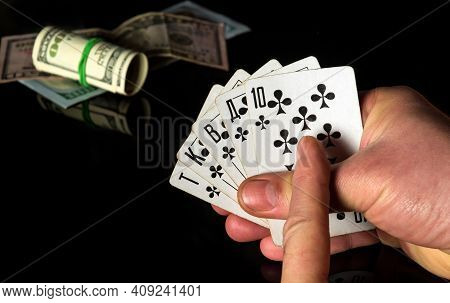Crossed Fingers Bring Good Luck. Poker Cards With Royal Flush Combination. Gambler Hand Is Holding P