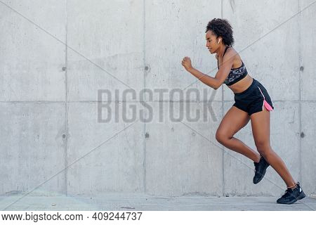 Afro Athletic Woman Running And Doing Exercise