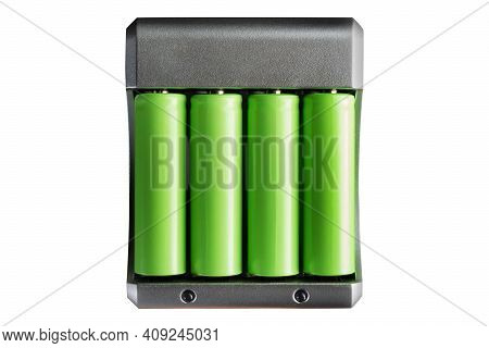Isolated Photo Of Green Colored Lithium Accumulator Batteries In Charger On White Background.