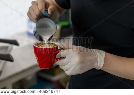 Close Up Barista Pouring Steamed Milk Into Coffee Cup Making Beautiful Latte, Cappuccino Art Rosetta