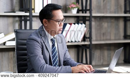 Asian Businessman Struggle With Laptop Computer, Frustrated Asia Man Looking At Computer While Worki