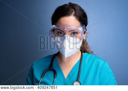 Portrait Of A Young Female Healthcare Worker Wearing Mask And Goggles