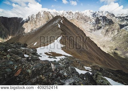 Atmospheric Minimalist Alpine Landscape With Massive Snowy Mountain Range. Snow Or Firn On Combe Roc