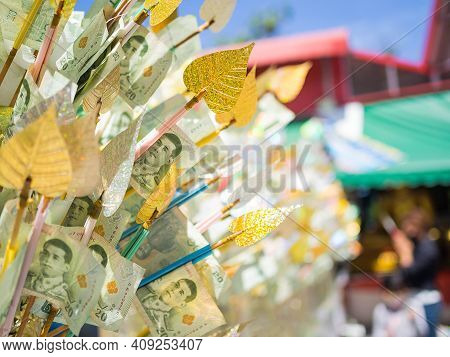 Buddhism Religion In Thailand With Thai Note Banks In Tree Branch With Pho Leave On Blur Image Is Am