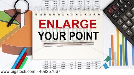 Notebook With Tools And Notes About Enlarge Your Point ,concept Business