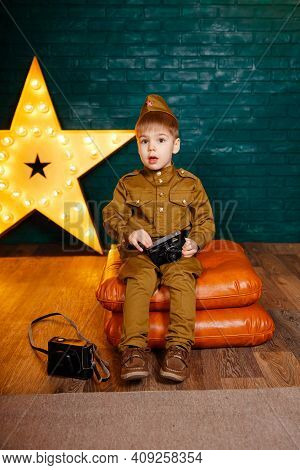 Child War Correspondent During The Second World War. Boy In Russian Military Uniform With Camera. Ph