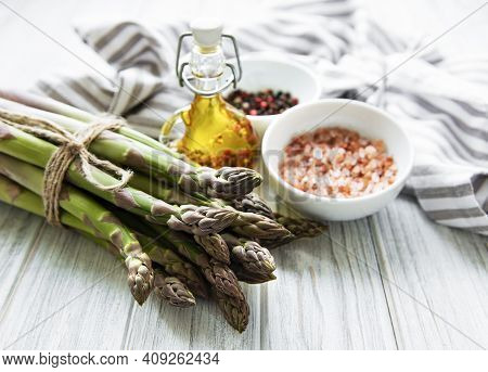 Bunch Of Raw Asparagus Stems With Different Spices And Ingredients On Wooden Background. Top View, F
